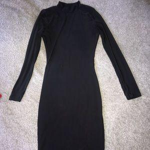Long sleeve black dress.